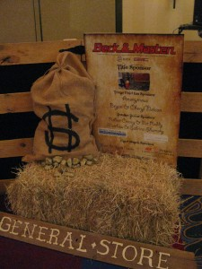 """Beck and Masten top the sign for SIRE's Casino Night """"Panning for Gold"""" feature."""