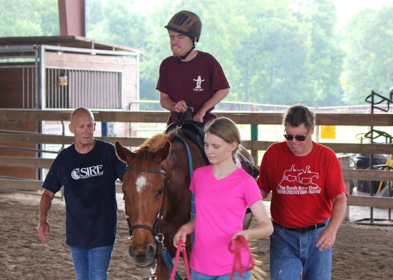 Rider, horse and volunteers