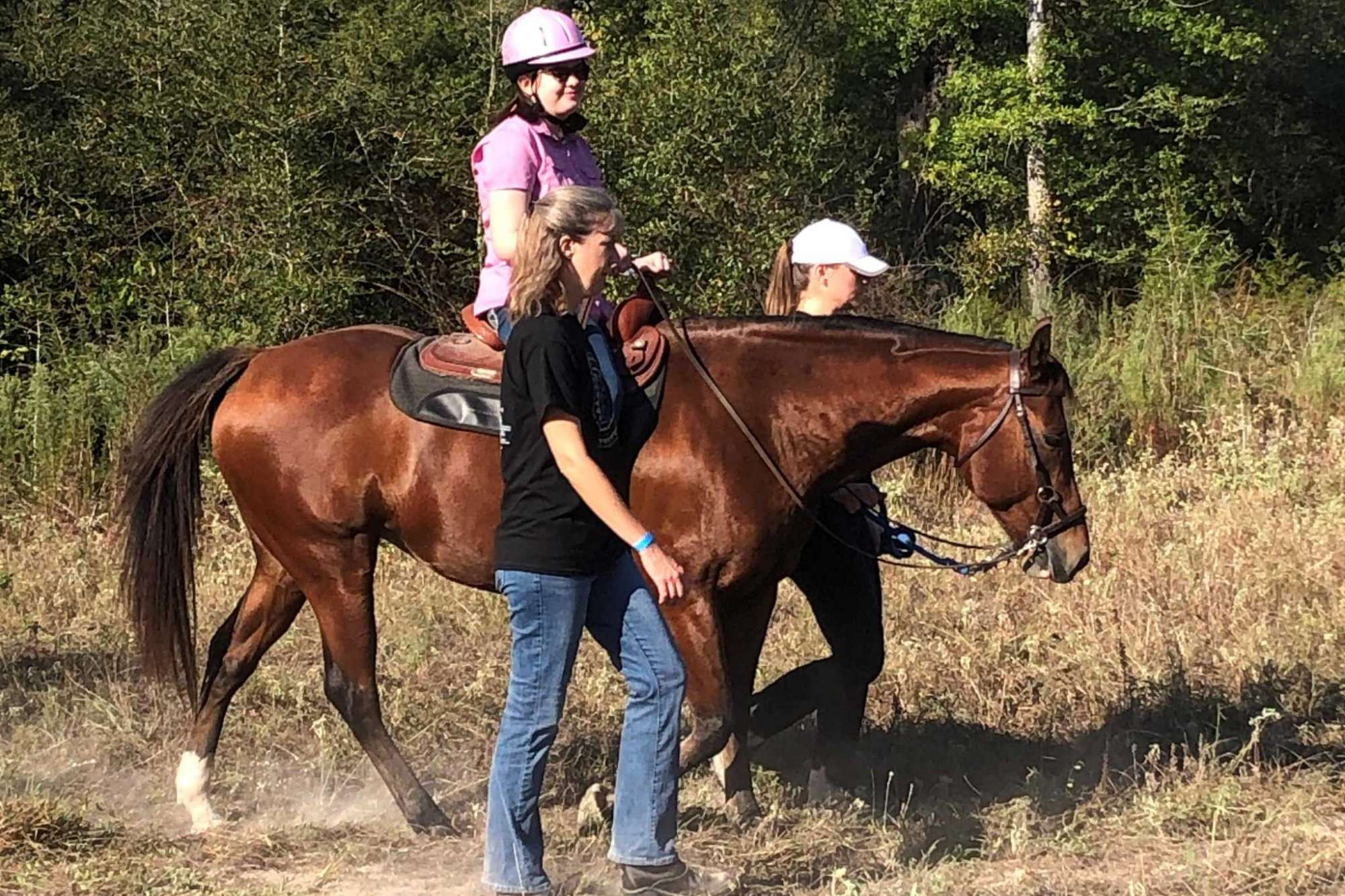 Ladana Igler rides a horse at the SIRE location in Spring.